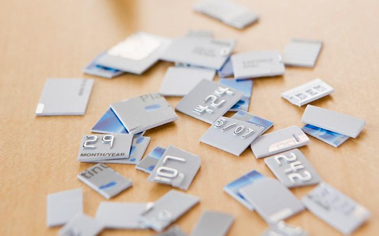 Shredded Credit Card on Wood