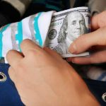 Person hiding money in a sock basket