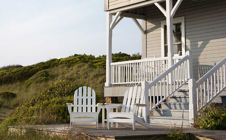 White House on a Hill with 2 outdoor Patio Chairs