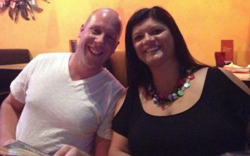 Travis and Vonnie smiling in a restaurant