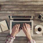 guy blogging on his laptop