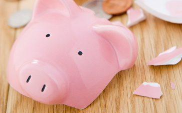 Broken Pink Piggy Bank on Wood