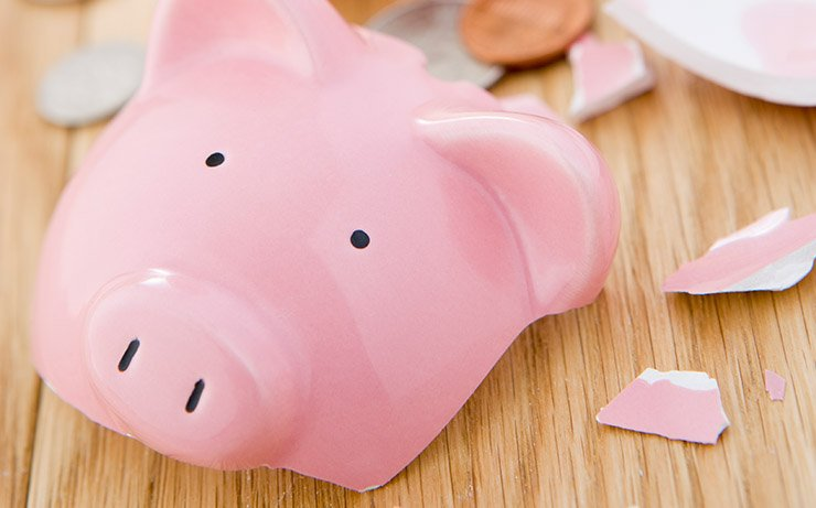 Broken Pink Piggy Bank on Wood