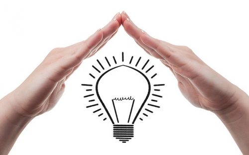 light bulb and hands representing investing ideas
