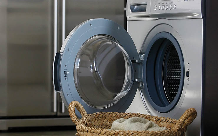 Laundry Machine in Kitchen With Laundry Basket
