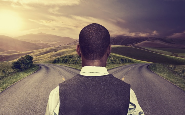 businessman in front of two roads hoping taking chance