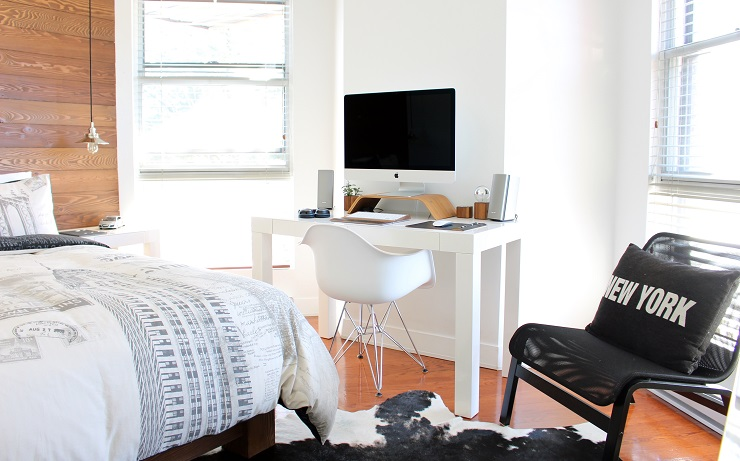bedroom with bed, chair and computer