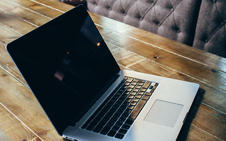 Macbook Laptop on Wooden Desk