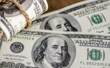 Hundred dollar bills rolled up