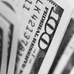 Black and white photo of 100 dollar bills close up photo