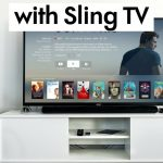 Sling TV ad on a flat screen TV sitting on a white cabinet PI
