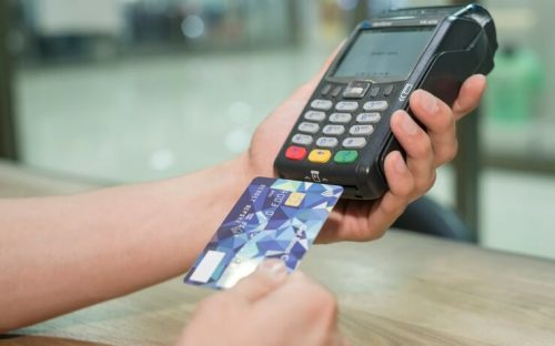 Person scanning debit card FI
