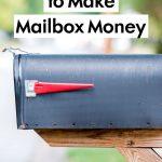 Black mailbox on wooden post PI