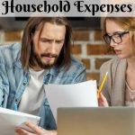 Man and woman at home budgeting at a computer PI