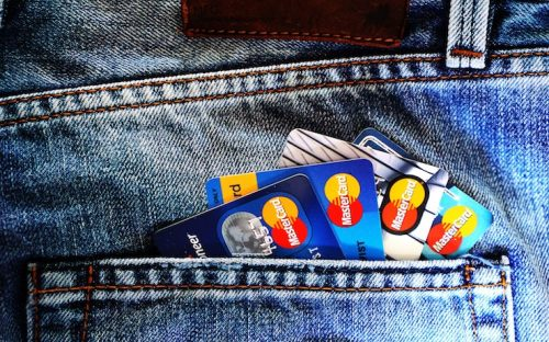 Credit cards arranged in a jeans pocket
