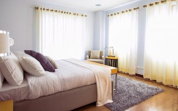 Nicely made bed in guest bedroom available for rent