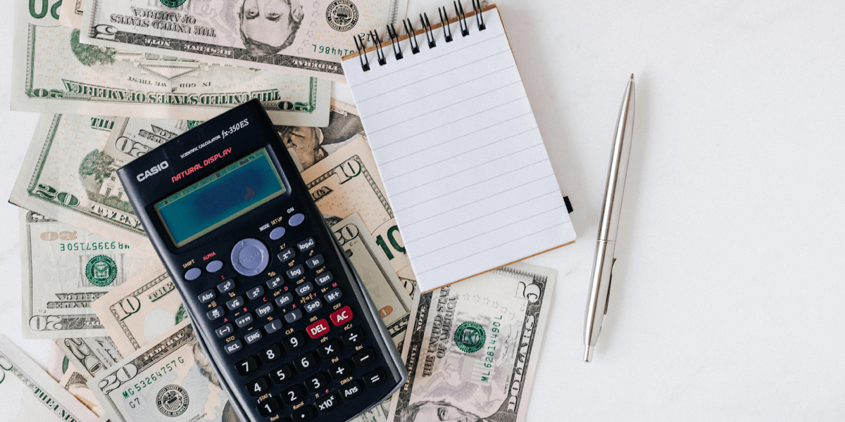 balancing a bank account with a calculator and notepad