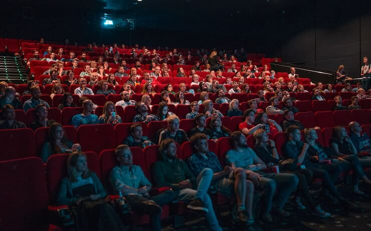 Audience watching a free screening of a movie