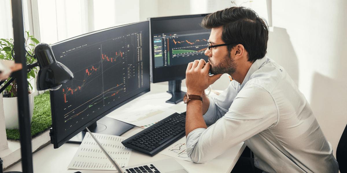 Person looking at computer screen charts