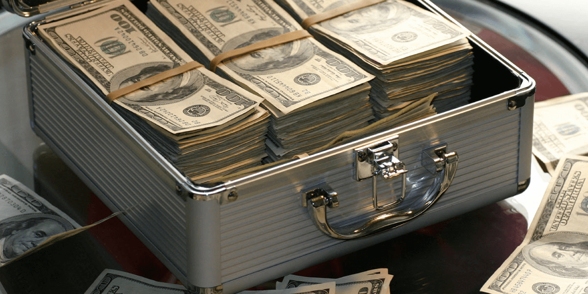 stack of cash for investing in an income producing asset