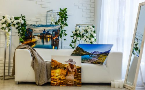Canvas prints laying on couch and floor