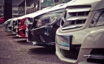 Line up of new mercedes cars that are for sale on a lot