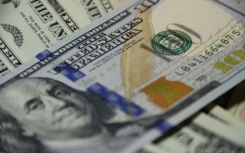 Close up photo of pile of hundred dollar bills