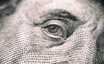 Close up of benjamin franklin on 100 dollar bill
