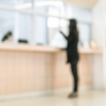 Person standing at bank teller desk