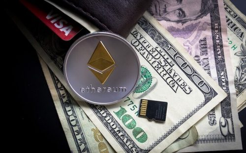 Ethereum coin leaning against wallet and cash