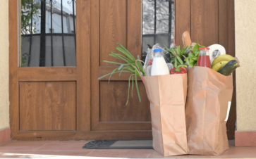 Picture of front door with grocery bags