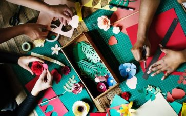 Friends crafting flowers to sell online