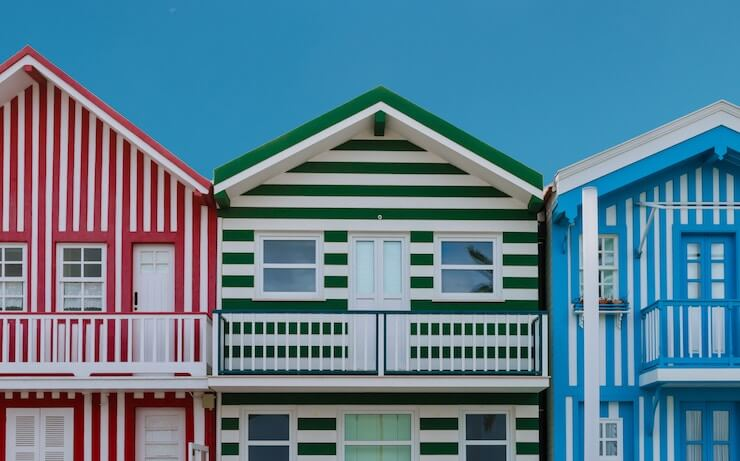 Red green and blue stripped houses that look like rental properties