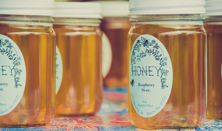 local honey in glass jar to be sold