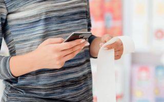 Person scanning receipt