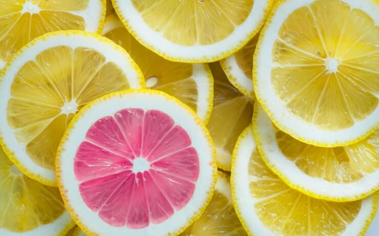 Pile of lemon slices with one dyed pink