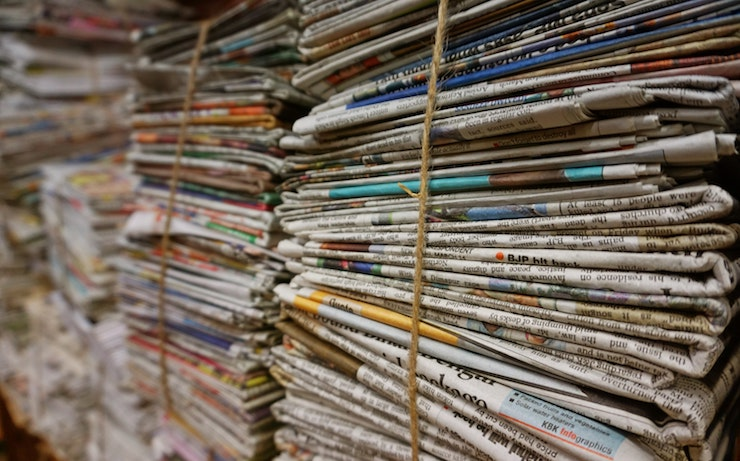 Stacks of news papers to be recycled bound with twine