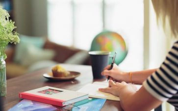 Woman spending time journaling and investing in herself