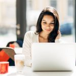 Woman looking into website hosting on her laptop