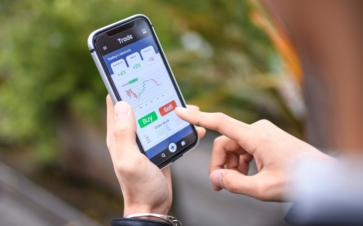 acorns investment app on mobile phone