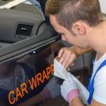 man using car advertise to make money