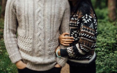 Couple wearing sweaters happy for their anniversary