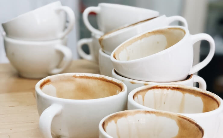 Dirty coffee cups waiting to be washed