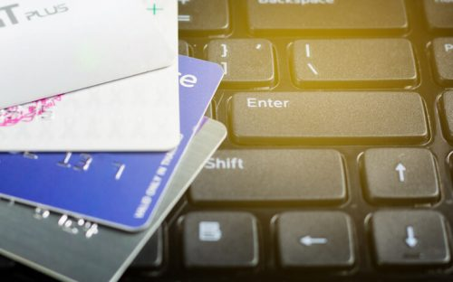 Giftcards laying on a keyboard