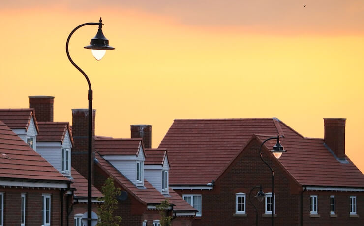 House with sunset behind with street lamp in the center