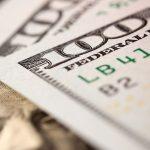Pile of new hundred dollar bills zoomed in