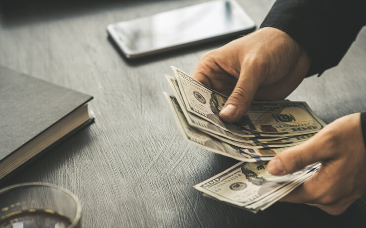 Man counting his money that he could put into savings