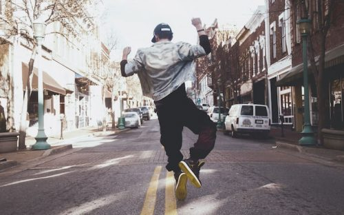 Man jumping for joy that he was able to get out of a payday loan