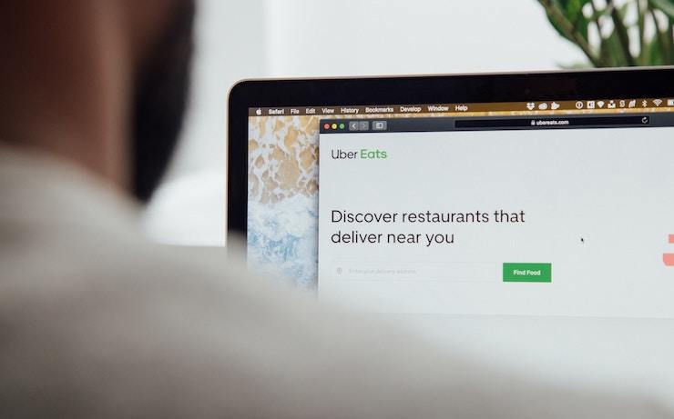 Man looking at uber eats on computer