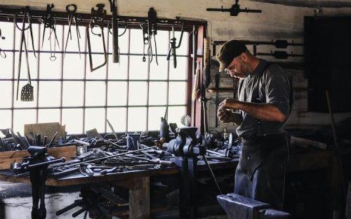 Man working with scrap metal to make money